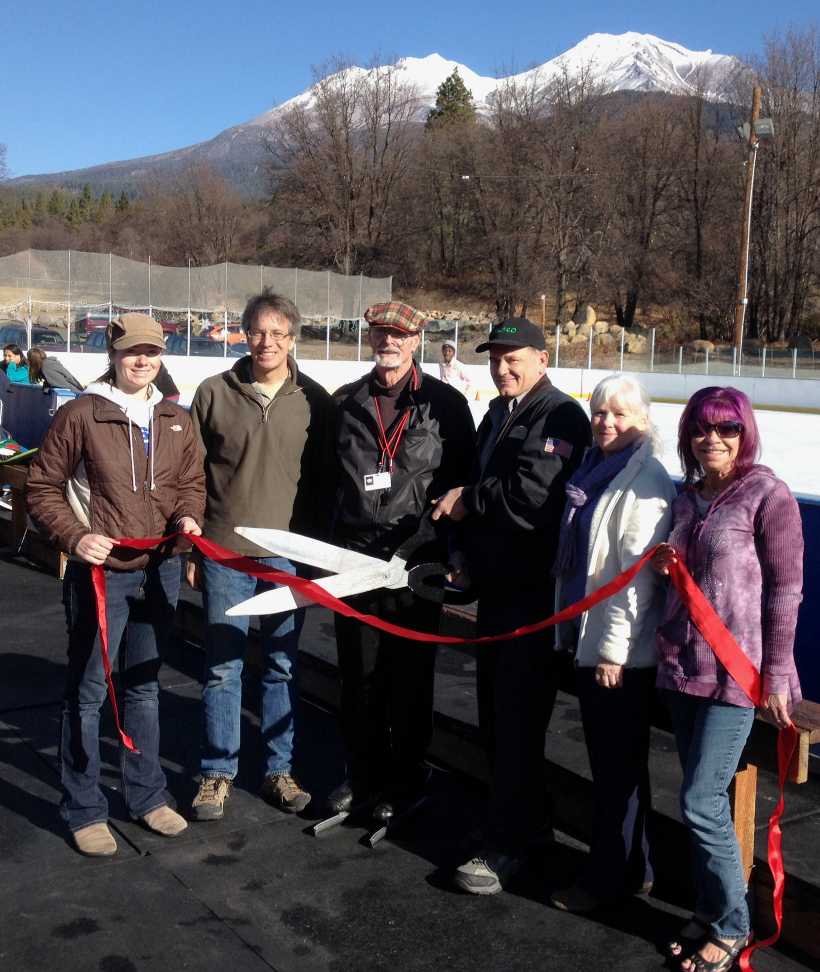 Participating in the Mt. Shasta Chamber of Commerce ribbon cutting for Friends of the Rink (F.O.R.) are, left to right, intern/volunteer Shannon Shaw, F.O.R. Board chairman Steve Bachmann, volunteer Norm Burkett, F.O.R. Board treasurer and rink manager John Stackfleth, F.O.R. Board vice-chairman Pauline Uri and Chamber events coordinator Vicky Zanni.
